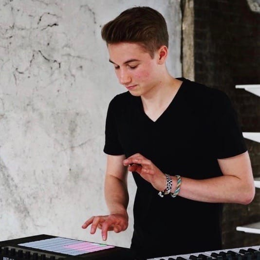 a boy playing a sample pad